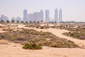 DUBAI, UAE - 1 APRIL 2014: Sandy scenery od Dubai at the Jumeirah Beach, UAE. Jumeirah Beach is a white sand beach that is located and named after the Jumeirah district of Dubai.