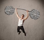 Strong muscular man fighting with stress
