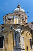 Statue Of San Carlo And The Basilica In Rome, Italy