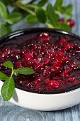 Lingonberry Jam (cowberries) And Branches With Leaves