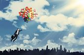 Woman Flying With Balloons To Get Her Dream 1