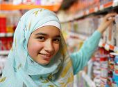 stock photo of hijabs  - Beautiful Muslim girl posing with hijab and smiling - JPG