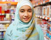 Beautiful Muslim girl posing with hijab and smiling