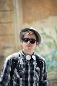 Portrait of urban teenager with sunglasses and hat