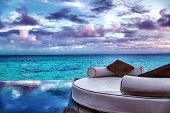 Luxury beach resort, beautiful cozy white lounger near pool, perfect place for honeymoon, gorgeous seascape in overcast weather, summer vacation concept