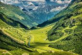 Majestic mountains view, little river in the mountainous valley, beauty of fresh green nature, panor