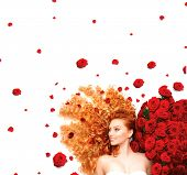 foto of perm  - Beauty model girl with long curly red hair and beautiful red roses hairstyle - JPG