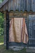 Draped fabric that hides a memorial, the board