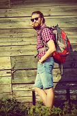 Young man hiking in the countryside. Active lifestyle, tourism.