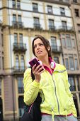 Sporty Urban Woman Texting Message On Smartphone In Street