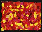 Texture from many pieces of torn red and yellow paper