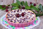 Clafoutis with cherry in ceramic form