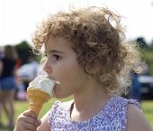 Young child eating an ice cream cone.