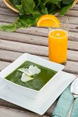 Spinach Cream Soup And A Glass Of Fresh Orange Juice