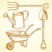 pic of hand-barrow  - Garden fork barrow watering can and shovel vintage background - JPG