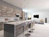 Rustic style wooden open-plan kitchen interior with a long bar counter and stools in a spacious livi