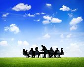 Business People Discussing Around The Conference Table Outdoors In A Scenic View