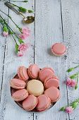 stock photo of carnations  - Pink macaroon with pink carnations on a white wooden table - JPG