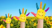 Three Painted Hands Of Family On Sunflowers Field