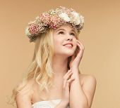 picture of young woman wearing wreath of flowers