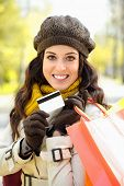 Woman With Shopping Bags And Credit Card On Autumn