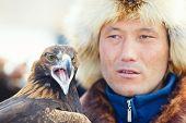 Nura, Kazakhstan - February 23: Eagle On Man's Hand In Nura Near Almaty On February 23, 2013 In Nura