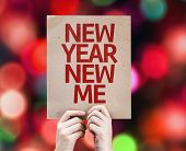 New Year New Me card with colorful background with defocused lights