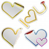 White blank heart shaped stickers with golden frames isolated on white background.