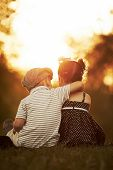 lovely boy and girl on sunset