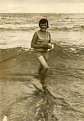 GERMANY, CIRCA 1940s: Vintage photo of young woman on beach
