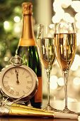 Glasses of champagne with festive background for the holidays
