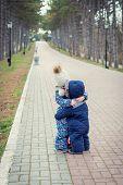 Little Sister Hugs Her Toddler Brother