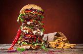 Delicious big hamburger on wooden background