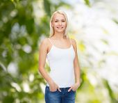 t-shirt design concept - smiling woman in blank white tank top
