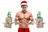 Muscular Santa Claus Doing Exercises With Gifts Over White Background