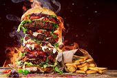 Delicious big hamburger on wooden background