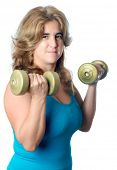 Hispanic woman exercising with weights raising a pair of dumbbells isolated on white