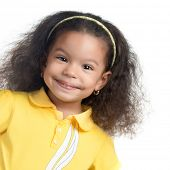 Cute african american small girl smiling isolated on white