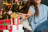 Young woman with christmas present boxes