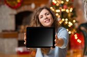 Woman showing tablet pc with copy-space