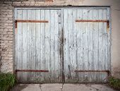 picture of neglect  - Old wooden neglected garage door with broik wall - JPG