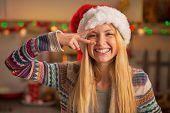 Portrait Of Happy Teenager Girl In Santa Hat Having Fun Time