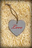 Red Inscribed Wooden Love Heart In Nest
