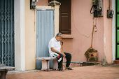 LUANG PRABANG LAOS - OCTOBER 26; Unidentified man sleeping on the street on October 26 2014 Luang Pr