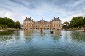 Luxembourg Palace And Reflection In The Pond With Fountain
