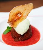 Chocolate fondant with berry sauce and ice-cream