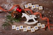 Merry Christmas Greeting Card On Wooden Background