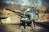 Retro Filtered Photo Of A Antiaircraft Gun.