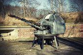 Retro Filtered Photo Of A Antiaircraft Gun.
