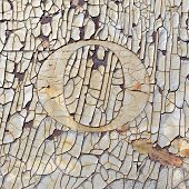 picture of zero  - grunge rusty metal background with chipped and cracked paint and the number zero or letter o - JPG